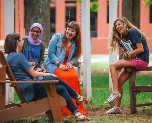 Students sitting outside in chairs